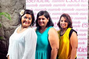 Pricilla Samuel, coordinatrice de production chez Graphic Press, entourée de Nadia Joseph et Charlène Augustin.