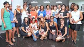 Les coiffeurs des 22 «Temples», partenaires Mizani, en compagnie de la formatrice internationale Adélaïde Ayefouni  et des responsables de BrandActiv.