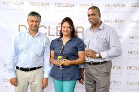 Djilane Hisaindee, Finance & Administrative Manager de BrandActiv, Suren Venkaya, directeur de Lacase Chamarel, et son épouse.